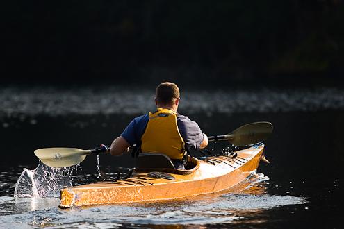 Photo of man kayaking