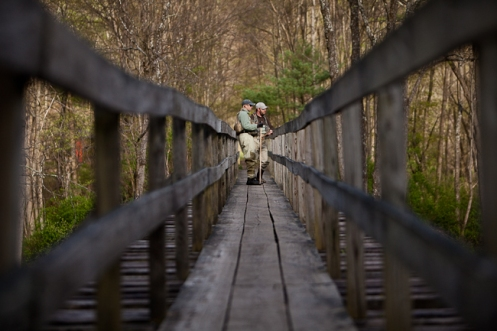 picture of fly fisherman on a bridge