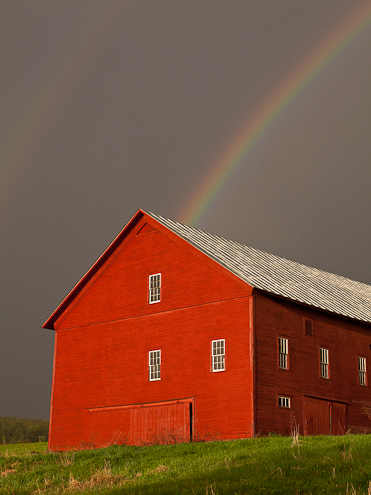 red barn and rainbow image